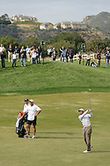 Tiger Woods hits an approach shot on hole 6 during Round 3 of the 2010 Chevron World Challenge at the Sherwood Country Club in Thousand Oaks, Calif., on Saturday, Dec. 4, 2010.