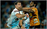 GOLD COAST, AUSTRALIA - SEPTEMBER 03:  Greg Bird of the Titans is tackled by Robert Lui during the round 26 NRL match between the Gold Coast Titans and the Wests Tigers at Skilled Park on September 3, 2010 on the Gold Coast, Australia.  (Photo by Matt Roberts/Getty Images) *** Local Caption *** Greg Bird