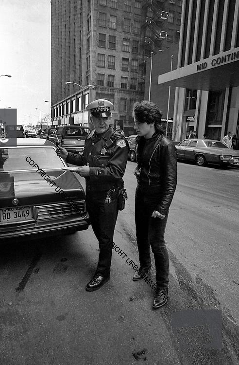 U2  - Photo of Bono - USA tour photosessions in Chicago - December 1981 of Bono and Chicago Policeman - USA tour photosessions in Chicago - December 1981