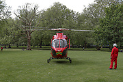 An air ambulance helicopter is seen preparing to take off inside Southwark Park in Bermondsey, London after they delivered an NHS emergency medical response unit to a road traffic accident after a motorbike and a car collided in Lower Road intersection with Neptun Street near Canada Water Station on Monday, May 4, 2020. (Photo/ Vudi Xhymshiti)