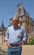 Jean-Francois Quenin, owner and wine maker in front of his chateau  Chateau de Pressac St Etienne de Lisse  Saint Emilion  Bordeaux Gironde Aquitaine France