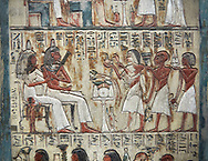 Ancient Egyptian funerary stele of painter Maya, limestone, New Kingdom, 18th Dynasty, (1336-1292 BC), Deir el-Medina,  Egyptian Museum, Turin. Drovetti cat 1579.<br /> <br /> <br /> In the upper portion Maya and his wife Tamit pay homage to Osiris and Hathor, the gods of the necropolis. In the lower register is a similar scene in which his wife recieves food offerings from their many children, as was traditional at the time. .<br /> <br /> If you prefer to buy from our ALAMY PHOTO LIBRARY  Collection visit : https://www.alamy.com/portfolio/paul-williams-funkystock/ancient-egyptian-art-artefacts.html  . Type -   Turin   - into the LOWER SEARCH WITHIN GALLERY box. Refine search by adding background colour, subject etc<br /> <br /> Visit our ANCIENT WORLD PHOTO COLLECTIONS for more photos to download or buy as wall art prints https://funkystock.photoshelter.com/gallery-collection/Ancient-World-Art-Antiquities-Historic-Sites-Pictures-Images-of/C00006u26yqSkDOM