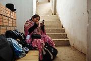 """Maria Eugenia Herrera Mamani, alias """"Claudina the Cursed"""", makes herself up in the dressing room of the Community Center El Alto where wrestling show take place all Sundays. The Cholitas wear the traditional costumes of Aymara people during wrestling shows, El Alto, Bolivia, February 26, 2012.<br /> SPANISH: María Eugenia Mamani Herrera, alias Claudina La Maldita se maquilla el rostro en el área de vestidores ubicado en la parte trasera del Multifuncional El Alto donde cada domingo se presenta el espectáculo de lucha libre. Las Cholitas usan la vestimenta tradicional de los Aymara cuando entran al ring a luchar, en El Alto, Bolivia, el 26 de Febrero de 2012."""