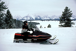 WY: Grand Teton National Park, snow mobile, transportation in winter    .Photo Copyright: Lee Foster, lee@fostertravel.com, www.fostertravel.com, (510) 549-2202.Image: wygran214
