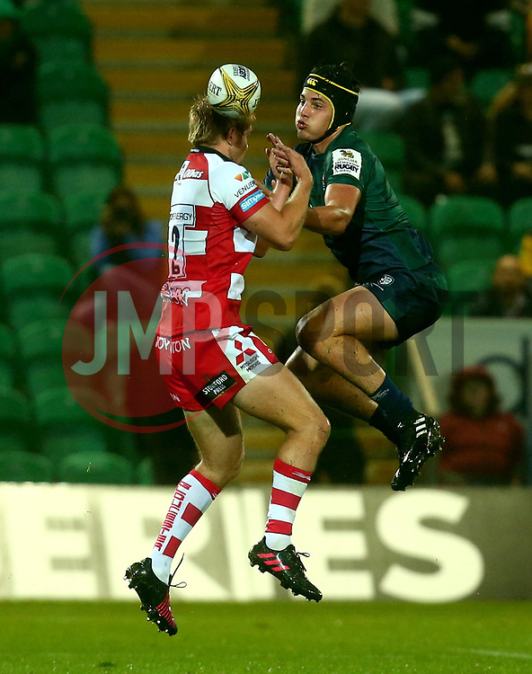 Josh Basham of London Irish challenges Jacob Morris of Gloucester Rugby to the ball - Mandatory by-line: Robbie Stephenson/JMP - 28/07/2017 - RUGBY - Franklin's Gardens - Northampton, England - Gloucester Rugby v London Irish - Singha Premiership Rugby 7s