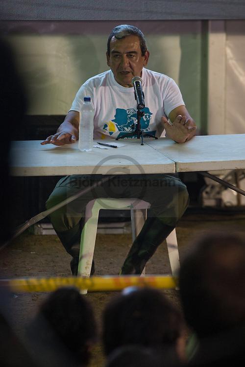 """El Diamante, Meta, Colombia - 17.09.2016        <br /> <br /> Jaime Alberto Parra alias Mauricio Jaramillo and """"El Medico"""", member of the seven members strong FARC leadership group Secretariat, holding a press statement after the first day of the 10th conference of the marxist FARC-EP in El Diamante, a Guerilla controlled area in the Colombian district Meta. Few days ahead of the peace contract passing after 52 years of war with the Colombian Governement wants the FARC decide on the 7-days long conferce their transformation into a unarmed political organization. <br /> <br /> Jaime Alberto Parra alias Mauricio Jaramillo bzw. El Medico, Mitglied des Sekretariat, also der siebenköpfigen FARC Fuehrung, gibt ein Pressestatement nach dem ersten Tag, der zehnten Konferenz der marxistischen FARC-EP in El Diamanten. El Diamanten liegt in einem von der Guerilla kontrollierten Gebiet in der kolumbianischen Region Meta. Wenige Tage vor der geplanten Verabschiedung eines Friedensvertrags nach 52 Jahren Krieg mit der kolumbianischen Regierung will die FARC auf ihrer sieben taegigen Konferenz die Umwandlung in eine unbewaffneten politischen Organisation beschließen. <br />  <br /> Photo: Bjoern Kietzmann"""