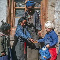 Ben Wiltsie, an American toddler, shares baloons wtih Sherpa girls while trekking with his parents in the Khumbu region of Nepal.