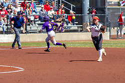 NORMAL, IL - April 06: Courtney Krodinger rounds third as Emme Olson throws out the hitter at first during a college women's softball game between the ISU Redbirds and the University of Northern Iowa Panthers on April 06 2019 at Marian Kneer Field in Normal, IL. (Photo by Alan Look)