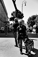 """Anti riot policewoman with her dog during the protest at Circo Massimo in Roma. The protest is call from several ultras IIalian football clubs and far-righ political parties against the Italian Government . <br />The movement """"I Ragazzi d'Italia"""" born after the decision of the Italian Government to lockdown the nation after the spread of Covid-19. The movement protest against the the economic crisis caused by the lockdown, 6th June, Roma, Italy."""