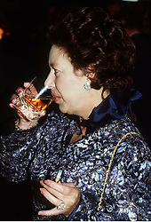 Princess Margaret drinking and smoking.