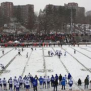 Action during the New Canaan Rams Vs Darien Blue Wave, CIAC Football Championship Class L Final at Boyle Stadium, Stamford. The New Canaan Rams won the match in snowy conditions 44-12. Stamford,  Connecticut, USA. 14th December 2013. Photo Tim Clayton