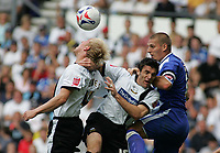 Photo: Paul Thomas.<br /> Derby County v Cardiff City. Coca Cola Championship.<br /> 20/08/2005.<br /> <br /> Andrew Davies, Marc Edworthy and Cardiff Captain Darren Purse compete for the ball.