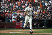 San Francisco Giants first baseman Buster Posey (28) runs out a hit against the Colorado Rockies at AT&T Park in San Francisco, California, on September 20, 2017. (Stan Olszewski/Special to S.F. Examiner)