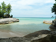 """A girl walking at The Cove. Image from the area known as """"The Cove,"""" Pictured Rocks National Lakeshore, Michigan, USA."""