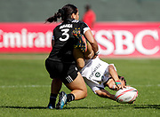 Dubai UAE. Stacy Waaka from New Zealand, tackles Mathrin Simmers from South Africa's during the HSBC World Rugby Women's Sevens Series, 30 November 2017. Photo By Francois Steenkamp/SPORTDXB / www.photosport.nz