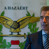 Anders Fogh Rasmussen secretary general of NATO talks during a press conference after he opened a new hangar construction area of the Strategic Airlift Capability (SAC) programme in Papa (about 165 km west of Budapest), Hungary on July 01, 2013. ATTILA VOLGYI