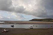 Boats moored on the sands at Parrog, Newport in Pembrokeshire, Wales, United Kingdom. Newport is a town, parish, community, electoral ward and ancient port of Parrog, on the Pembrokeshire coast in West Wales at the mouth of the River Nevern in the Pembrokeshire Coast National Park.