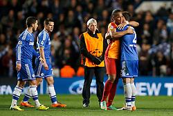 Chelsea Defender Branislav Ivanovic (SRB) is hugged by Galatasaray Forward Didier Drogba (CIV) - Photo mandatory by-line: Rogan Thomson/JMP - 18/03/2014 - SPORT - FOOTBALL - Stamford Bridge, London - Chelsea v Galatasaray - UEFA Champions League Round of 16 Second leg.