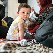 Mahdi 8 months old from Herat Afghanistan in Moria camp, Lesvos, Greece