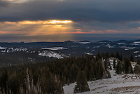 Crepuscular rays shine on the high plains of Wyoming shortly after sunrise as seen from the top of Sheep Mountain.