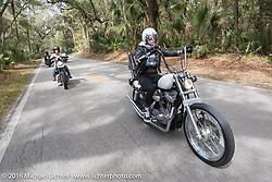 Savannah Burke riding through Tomoka State Park during Daytona Bike Week 75th Anniversary event. FL, USA. Thursday March 3, 2016.  Photography ©2016 Michael Lichter.
