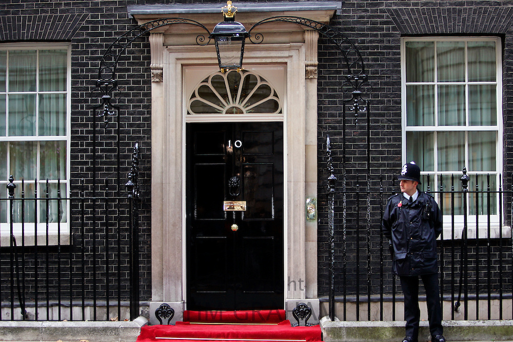 Armed policeman guards Number 10 Downing Street, the home of the British Prime Minister, London, United Kingdom