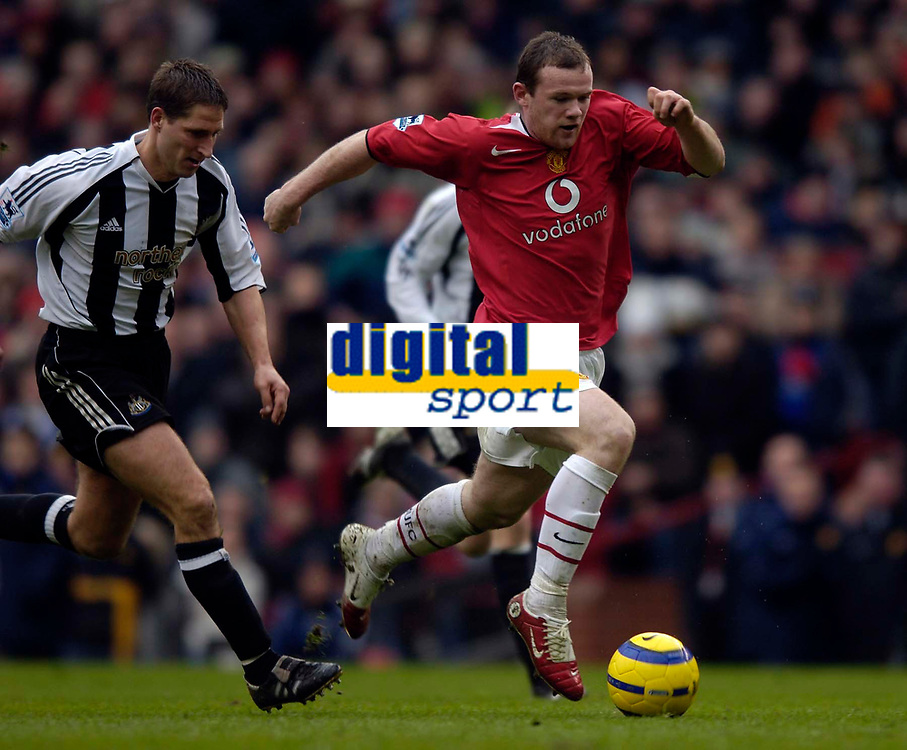 Photo: Jed Wee.<br /> Manchester United v Newcastle United. The Barclays Premiership. 12/03/2006.<br /> <br /> Manchester United's Wayne Rooney (R) breaks through the Newcastle defence in one of numerous runs in an eye catching performance.