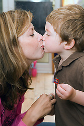 Little boy giving his Nanny a kiss,