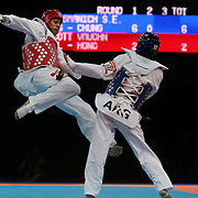 Vaughn Scott, New Zealand, (red) in action against Sebastian Eduardo Crismanich, Argentina, (blue) during the Taekwondo Men 80kg competition during the London 2012 Olympic games. London, UK. 10th August 2012.