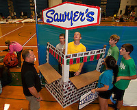 """Sophomore's Cameron Fraser and Ethan Carrier get ready to reopen Sawyers in their """"Summer"""" season hallway on Thursday evening in preparation of Gilford High School's Four Seasons Homecoming.  (Karen Bobotas/for the Laconia Daily Sun)"""