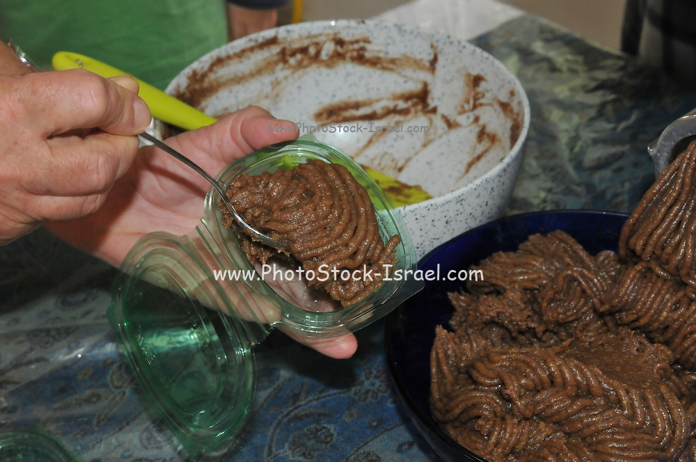 Making Charoset a sweet, dark-colored paste made of fruits and nuts eaten at the Passover Seder. Its color and texture are meant to recall mortar (or mud used to make adobe bricks) which the Israelites used when they were enslaved in Ancient Egypt