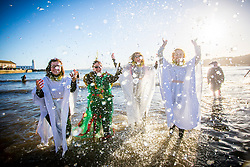 © Licensed to London News Pictures. 01/01/2019. Scarborough UK. Ladies dressed as angels where among the Swimmers braving the cold sea water on New Years day 2019 in Scarborough on the Yorkshire coast. Photo credit: Andrew McCaren/LNP