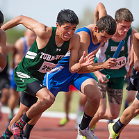 050914       Cable Hoover<br /> <br /> Tuba City Warrior Anthony Masayesva leads off the 4x800 relay during the Arizona State Track Meet at Mesa Community College in Mesa Friday.