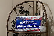 American Slaves, Inc., license plate on display during a poetry reading at the First Church of American Slaves at 314 Dr. W. J. Hodge Street, Thursday Aug. 25, 2011 in Louisville, Ky. (Photo by Brian Bohannon)