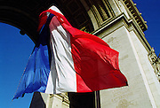 French Tricolore flag at the Arc de Triomphe for Remembrance Day in Paris, France