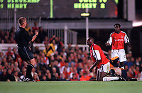 Patrick Vieira (Arsenal) about to be shown the red card by referee Graham Poll after a tackle on Liverpools Dietmar Hamann. Arsenal 2:0 Liverpool, F.A.Carling Premiership, 21/8/2000. Credit : Colorsport / Stuart MacFarlane.