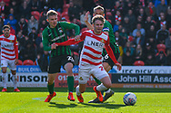 Kieran Sadlier of Doncaster Rovers (22) goes down after been tackled during the EFL Sky Bet League 1 match between Doncaster Rovers and Coventry City at the Keepmoat Stadium, Doncaster, England on 4 May 2019.