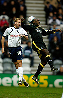 Photo: Paul Greenwood/Sportsbeat Images.<br />Preston North End v Cardiff City. Coca Cola Championship. 29/12/2007.<br />Preston's Liam Chilvers (L) beats Jimmy Floyd Hasselbaink in the air