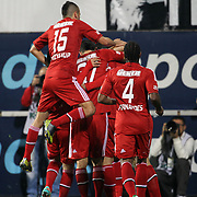 Besiktas's celebrates his goal Hugo Almeida, Filip Holosko, Oguzhan Ozyakup, Manuel Fernandes (L-R) during their Turkish Superleague soccer match Besiktas between Mersin idman Yurdu at BJK Inonu Stadium in Istanbul Turkey on Sunday, 04 November 2012. Photo by TURKPIX