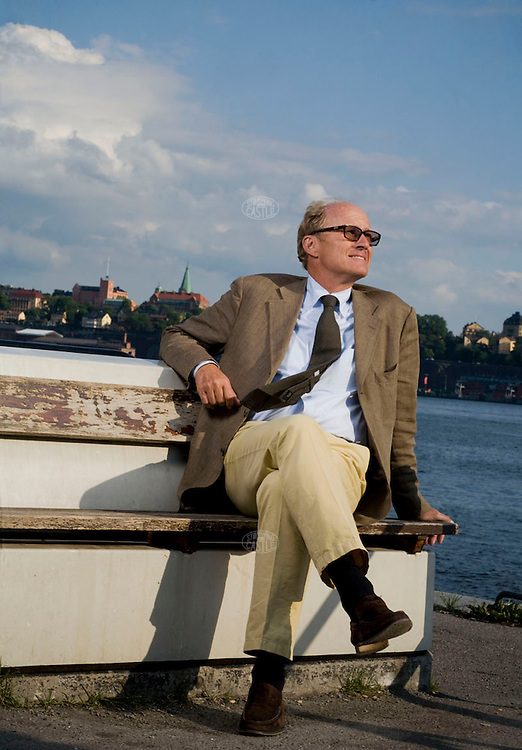 Photo ©2008 Tom Wagner,  ©Tom Wagner 2008, all rights reserved, all moral rights asserted..©Tom Wagner 2008, all rights reserved, all moral rights asserted..Portrait of Mats Qviberg, Vice Chairman of Investment AB Oresund (a Swedish Investment company), photographed in Stockholm, Sweden, down by the waterfront of the city, near the Old Town, and with the Royal Castle in the background. .