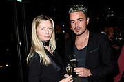 Zwarte loper Vogue Man x Hugo Boss, Exclusive party in het Stedelijk Museum.<br /> <br /> Op de foto:  Dinand Woesthoff en partner Lucy Woesthoff