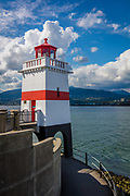 Brockton Point is a point and attached peninsula in Vancouver on the north side of Coal Harbour. Named after Francis Brockton, it is the most easterly part of Stanley Park and is home to a 100-year-old lighthouse and several hand-carved totem poles made in British Columbia.<br /> <br /> Part of the land at the point was first cleared in 1865 in order to construct a sawmill. Due to rough currents around the point and a reef offshore, the Burnaby Shoal, however, the mill was built in Gastown and the point instead became the primary sports fields of early Vancouver. The main sporting venue, Brockton Oval, has been visited by cricket players such as Donald Bradman, Fred Trueman and Geoffrey Boycott. Cricket and rugby are still played here.