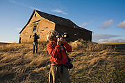 Photographers Jon Jantz (front) and Josh Stern take pictures at an abandoned barn in the Palouse Valley near Spokane, Washington.