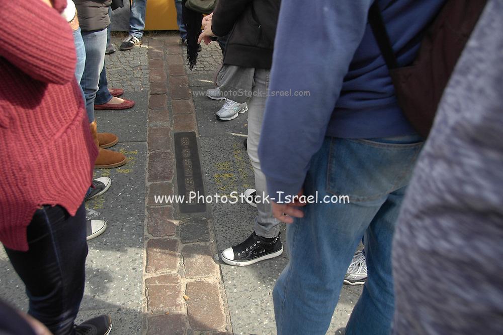 double row of bricks across berlin marks the position of the Berlin Wall (Berliner Mauer) Berlin, Germany