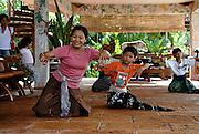 Teacher and pupils, traditional Balinese dance school. Sanur, Bali, Indonesia