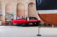 An exhibit of a modern boat at the Museo Storico Navale di Venezia, in Venice, Italy