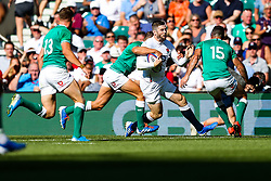 Elliot Daly of England is challenged by Jordan Larmour and Rob Kearney of Ireland - Rogan/JMP - 24/08/2019 - RUGBY UNION - Twickenham Stadium - London, England - England v Ireland - Quilter Series.