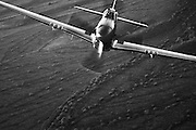 """Spectacular black and white photographic image of a P-51 Mustang """"Cripes A' Mighty"""" taken air to air over the Arizona desert"""