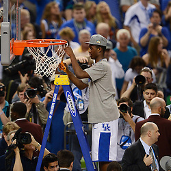 Apr 2, 2012; New Orleans, LA, USA; Kentucky Wildcats guard Doron Lamb cuts down the net after defeating the Kansas Jayhawks 67-59 in the finals of the 2012 NCAA men's basketball Final Four at the Mercedes-Benz Superdome. Mandatory Credit: Derick E. Hingle-US PRESSWIRE