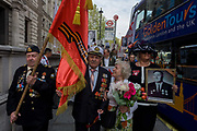 Russians living in the UK march through Westminster in central London to honour those fallen during the second world war 1939-45 9th May, 2016. Thousands of Russian-speakers gathered in Trafalgar Square, progressing via Downing Street the official residence of British Prime Minister David Cameron before continuing to Parliament Square.